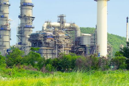 Oil refinery plant and refinery tank with blue sky background. 写真素材