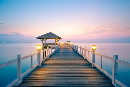 Wood bridge with seascape at twilight time. Stock Photo