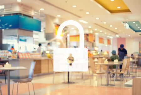 Unlock after the outbreak and spread the coronavirus concept with blurred image of food center background. Stock Photo