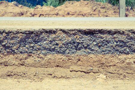 Asphalt road damage and repair work. Imagens