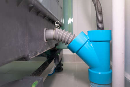 Flexible water drain pipe from washing machine and pvc pipe connector. Reklamní fotografie