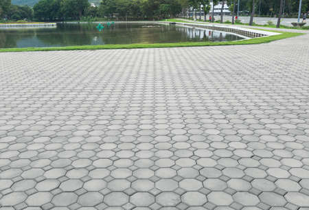 Truncated square tiling pattern of paver brick floor or block paving. Construction or lay on ground at outdoor use for road, street, pavement, sidewalk, floor, path, footpath, walkway and patio. Imagens