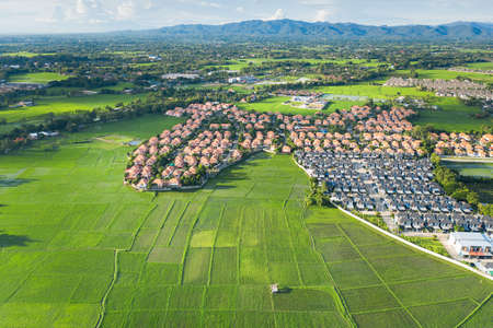 Housing subdivision or housing development. Also call tract housing. Large tract of land that divided into smaller. Business process by developer and builder. Aerial view in Chiang Mai of Thailand. Imagens