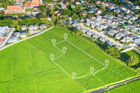 Land plot in aerial view. Identify registration symbol of vacant area for map. That property, real estate for business of home, house or residential i.e. construction, development, sale, rent and buy.