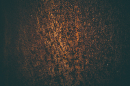 Rusted metal background in vintage style. Vintage metal texture. Abstract metal texture and background for designers. Old rusted metallic door. Close up view of corroded and rusted metal.