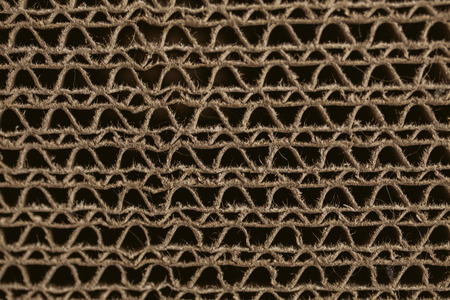 carboard box: Macro texture of cardboard. Cardboard corrugated pattern. Abstract texture and background for designers. Brown paper texture and pattern. Closeup view of cardboard background. Stock Photo