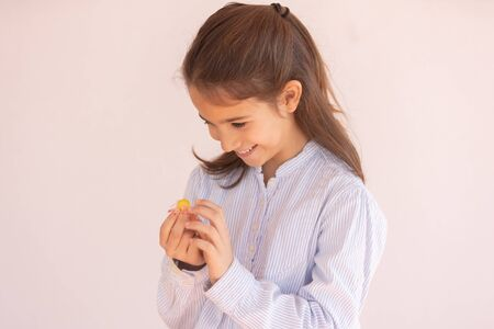 Little girl looking at a candy with desire