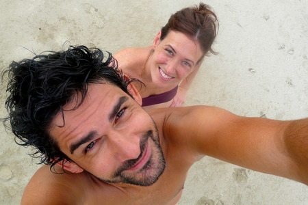 summer nature: Young couples portrait in Punta Uva beach, Puerto Viejo, Costa Rica Stock Photo
