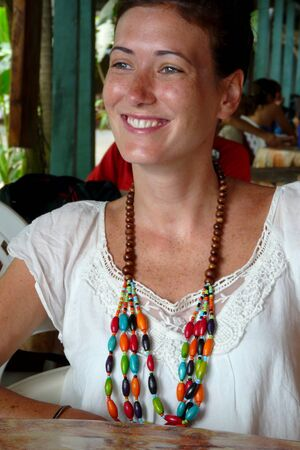 viejo: Wooden necklace worn by a cheerful young woman in Puerto Viejo, Costa Rica.