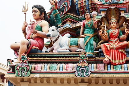 mariamman: Colorful statues placed over the roof of Sri Mariamman Temple, the oldest hindu temple in Singapore. Stock Photo