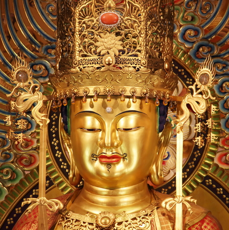 buddha: Singapore - October 16th of 2015: Portrait of main Buddha statue in the Buddha Tooth Relic Temple that was built to house Buddhas tooth relic allegedly found in a collapsed stupa in Myanmar in 1980.