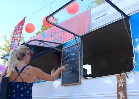 merce: Ciutadella Gardens, Barcelona - September 20th of 2014: Food sellers deliver worldwide meals in their vintage caravans. This curious activity takes place during La Merce Barcelonas festival.