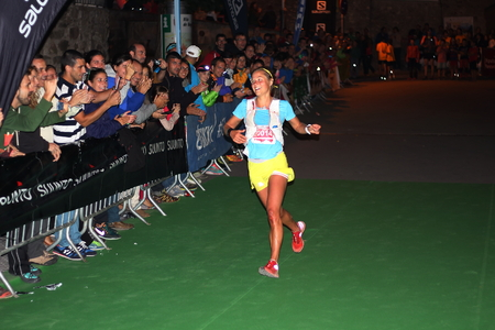 champion spain: Pyrenees mountains, Spain - September 19th of 2015: Trail runner world champion Mrs. Emelie Forsberg, shares victory with her fans after a long ride through the wild. Editorial