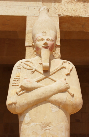 statue: Statue of Queen Hatshepsut surrounding the main entrance of her temple built between 1508 and 1458 BC, midway between the Valley of Kings and the Valley of Queens, Luxor Ancient Thebes, Egypt.