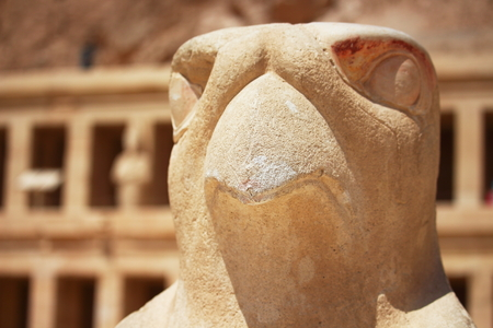 large rock: Eagle statue surrounding the main entrance of Temple of Queen Hatshepsut built between 1508 and 1458 BC, midway between the Valley of Kings and the Valley of Queens, Luxor Ancient Thebes, Egypt.
