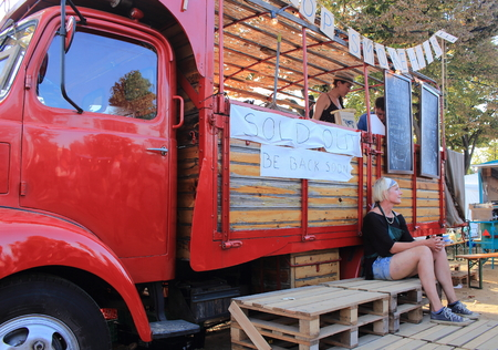 car retailer: Ciutadella Gardens, Barcelona - September 20th of 2014: Food sellers deliver worldwide meals in their vintage caravans. This curious activity takes place during La Merc Barcelonas festival.