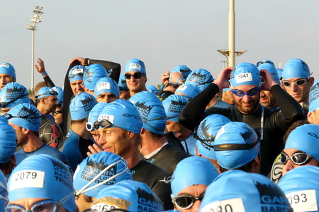swimming race: Barcelona, Spain - October, 17, 2010: Nervous triathletes waiting for the start of the swimming race during Barcelona Garmin Triathlon event, Barcelona, Catalonia, Spain