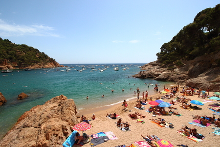 Tamariu, Girona, Spain - July 4th of 2015: Lots of tourists spend their summer holidays in Costa Bravas wonderful beaches and villages. The eastern mediterranean seaside of Spain is one of the most beautiful regions of this country. Editorial