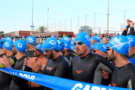 man head: Barcelona, Spain - October 5th of 2014: Triathletes waiting for the start of the swimming race during Barcelona Garmin Triathlon event, Barcelona, Catalonia, Spain