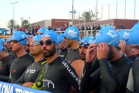 swimming race: Barcelona, Spain - October 5th of 2014: Triathletes waiting for the start of the swimming race during Barcelona Garmin Triathlon event, Barcelona, Catalonia, Spain