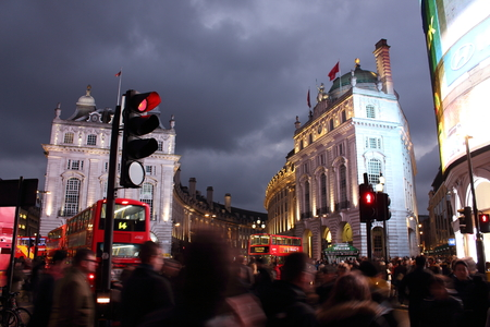 february 14th: Piccadilly Circus, London - February 14th of 2015: Lots of people, cars and typical red buses crossing the streets in this famous public space in Londons West End that was built in 1819.