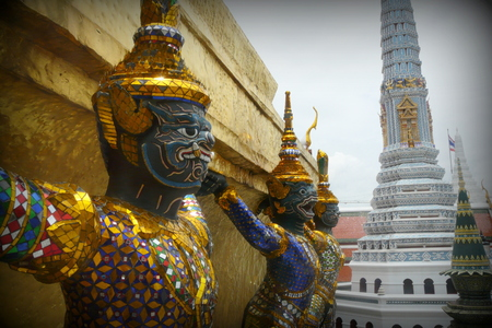 mystic place: A couple of guardian statues placed in front of a building ot the Imperial Grand Palace in Bangkok, Thailand