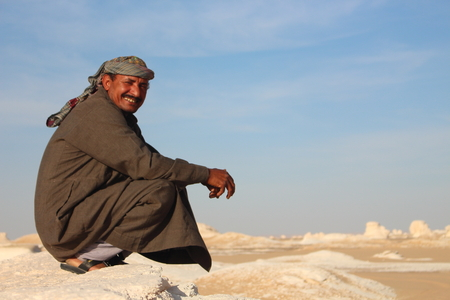 guides: White Desert, , Egypt - April 1st of 2015: After a long period of not receiving visitors,  bedouin local guides lead tourists back again to the White Desert National park close to Farafra Oasis.