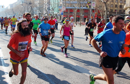competitiveness: Barcelona, Spain - March 13th of 2016: Athletes pushing hard during the 38th Barcelonas Marathon. This race has become the fifth larger marathon in Europe with 20.287 registered participants.