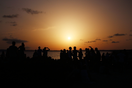 touristic: Wonderful sunset celebrated by many people at Pirata Bus Bar in Formentera, Balearic Islands, Spain. Stock Photo