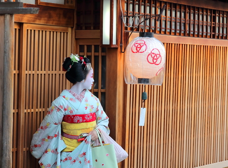 A maiko leaving a tea house in Miyagawacho neighborhood. Centuries ago, these female entertainers were so popular, but a few hundreds can be found now in Japan.