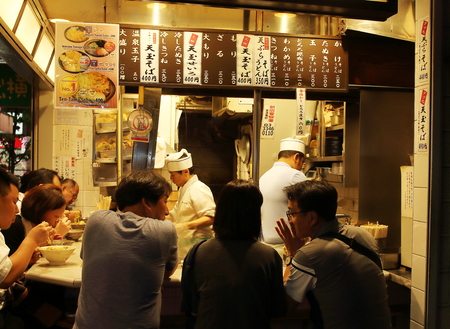 Tokyo, Japan - August, 2nd of 2017: Local people mixed with a few tourists dinning in Shinjuku Yakitori Yokocho street, a hidden small street to be found in the middle of Shinjuku business district. Redakční