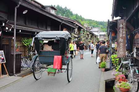 Takayama, Japan - August, 7th of 2017: Traditional jinrikisha in Takayamas old town where very well preserved buildings and whole streets of houses from the Edo Period (1600-1868) can be found. 報道画像