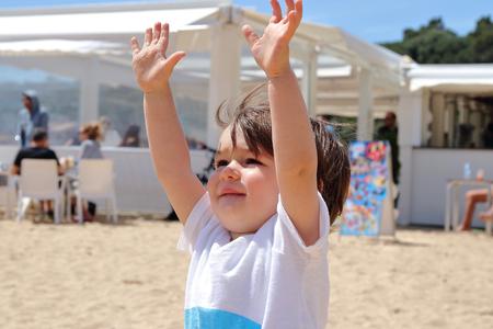 Portrait of 18 months old cute baby enjoying his time on the beach, Platja Castell, Costa Brava, Girona, Catalonia, Spain.