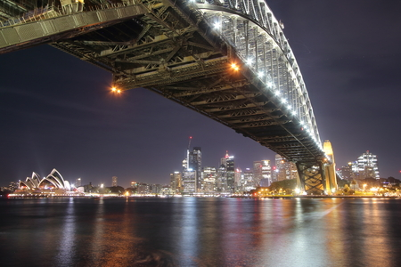 Harbour Bridge, Sydney, Australia - October, 23rd of 2018: Night view of this steel arch bridge that joins the Sydney central business district and the North Shore. Sydney Opera House on background.