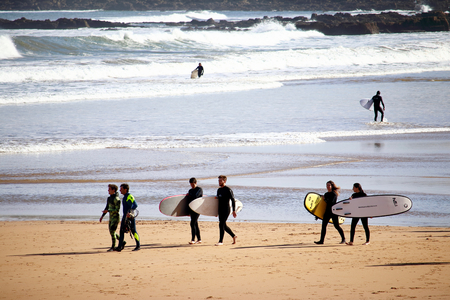 A pack of surfers enjoying their time at San Lorenzo beach during a sunny Easter morning.