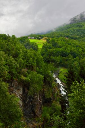 Amazing view of a wonderfull waterfall seen from Stalheimskleiva road, north of Voss village in the region of Hordaland, Norway. Stock Photo
