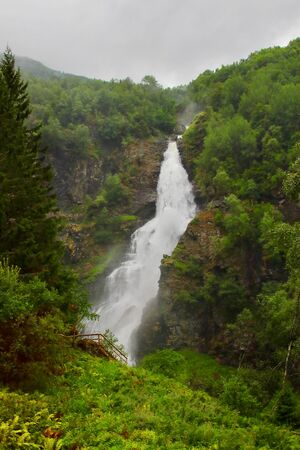 Amazing view of Sivlefossen fall, seen from Stalheimskleiva road. This is one of the most beautiful waterfalls in Norway located north of the village Voss in the region of Hordaland. Stock Photo