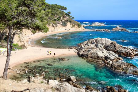 Main view of Cala Estreta beach, one of the most hidden and beautiful spots of la Costa Brava, an amazing mediterranean coast in the northern-eastern  seaside of Catalonia, Spain.