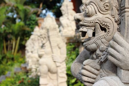 Detail of statues and sculptures placed in the garden outside Ubud Palace Puri Saren Agung, home of the Ubud royal family and one of the most visited spots of the whole city. Stock Photo