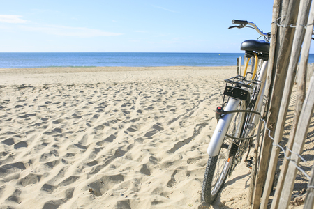 roussillon: bicycle parked on the sand of the Beach