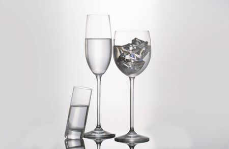 Isolated glass  and cup of water Stock Photo