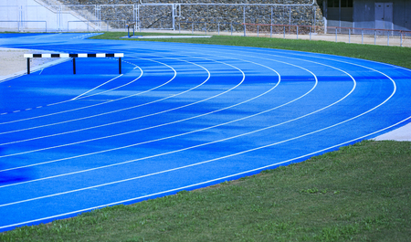 Blue athletic track in a stadium