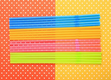 Straws with colorful topped background Stock Photo