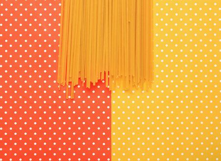 Spaghetti with colorful topped background