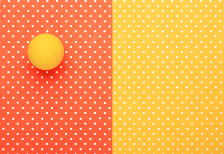 Yellow ball  with colorful topped background