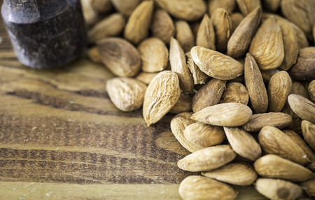 Group of almonds in a wooden table Stock Photo