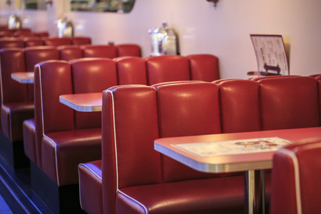 Red seats in a american restaurant