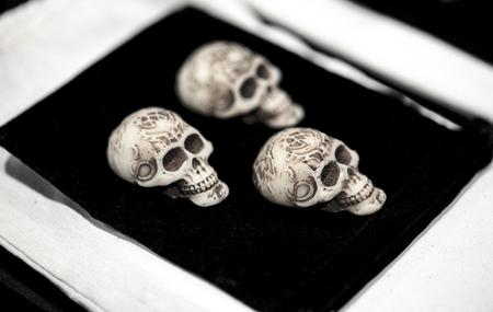 group of three ivory skulls