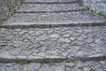 Stairs made of stones in a medieval city Stockfoto
