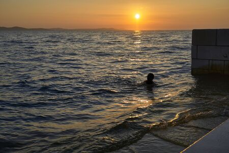 Silhouette in the Sunset of Zadar. Croatia. Europe